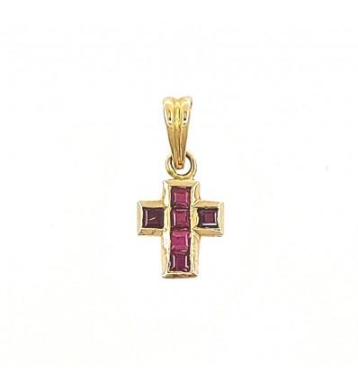 Cruz de oro con rubíes